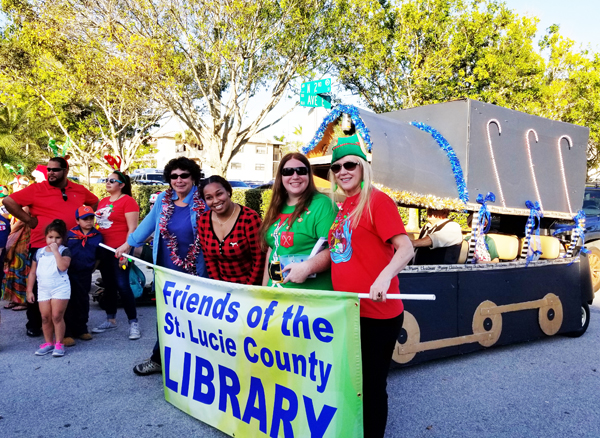 picture of Friends of the Library and Staff in Friends sponsored parade float