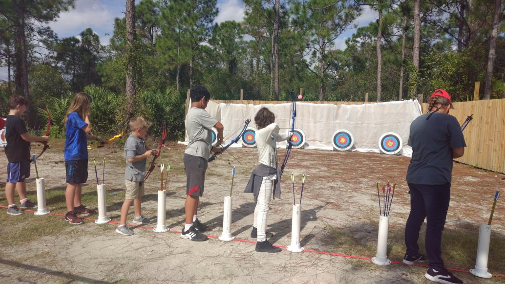 Photo of Archery Campers During a Tournament.