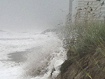 Storm winds and waves crashing on beach